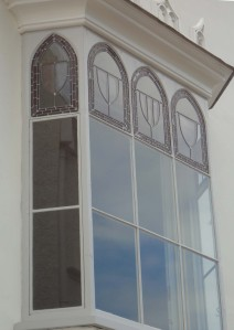 First floor stained glass window