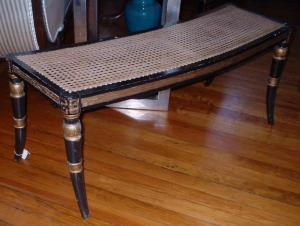 Antique Regency window seat with caned seating, sabre legs and gilt decoration