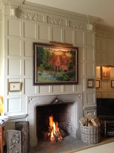 A snug with Jacobean panelling some rescued from the original house and restored. I love the fact that it has been painted to work with the rest of the house's interior